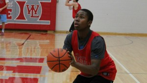 Nai Carlisle '16 shoots during practice.  Nai is playing in his first season as varsity point guard.