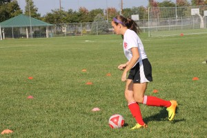 Kickin' It: Shelby Mann '14 weaves through cones during a practice.