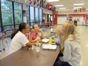 Lexi Umberger '17, Becky Oates '17, Allie Jin '17, and Brianne Abrahamson '17 use styrofoam lunch trays in the cafeteria.  The disposable styrofoam trays are used when the cafeteria does not have enough staff to wash reusable trays.