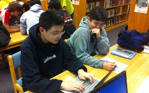 cracking Codes: Jerry Ma '14 and Harry Kim '14 spend their lunch going over code. Jerry Ma often spends his time in the library working with his friends.