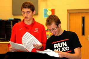 ON KEY: Ross Reeder '14 and Aaron Brehm '14 practice with the rest of Priority Male. They rehearse during lunch in the choir room.