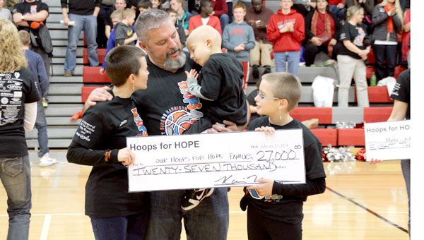 Kicking Cancer's Butt: This year, Hoops for Hope raised $27,000 for Eli Van Gorder.  He was diagnosed with stage IV brain cancer last October.