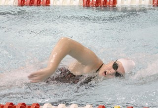 HUMAN FISH: Gutwein swims some laps during practice as she prepares for her last sectional.
