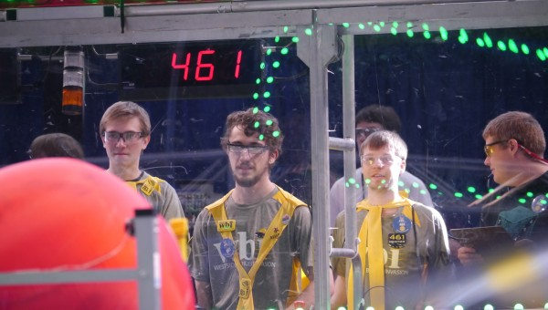 The drive team observes and controls their robot at the competition.