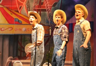 BARBERSHOP QUARTET: Seth Subeck, Alex Bouman, and Luke Richie belt out their love for pigs.  They all portray farmers who enter their beloved pigs in the State Fair.  Ben Shively (not pictured) is the fourth member of the quartet.