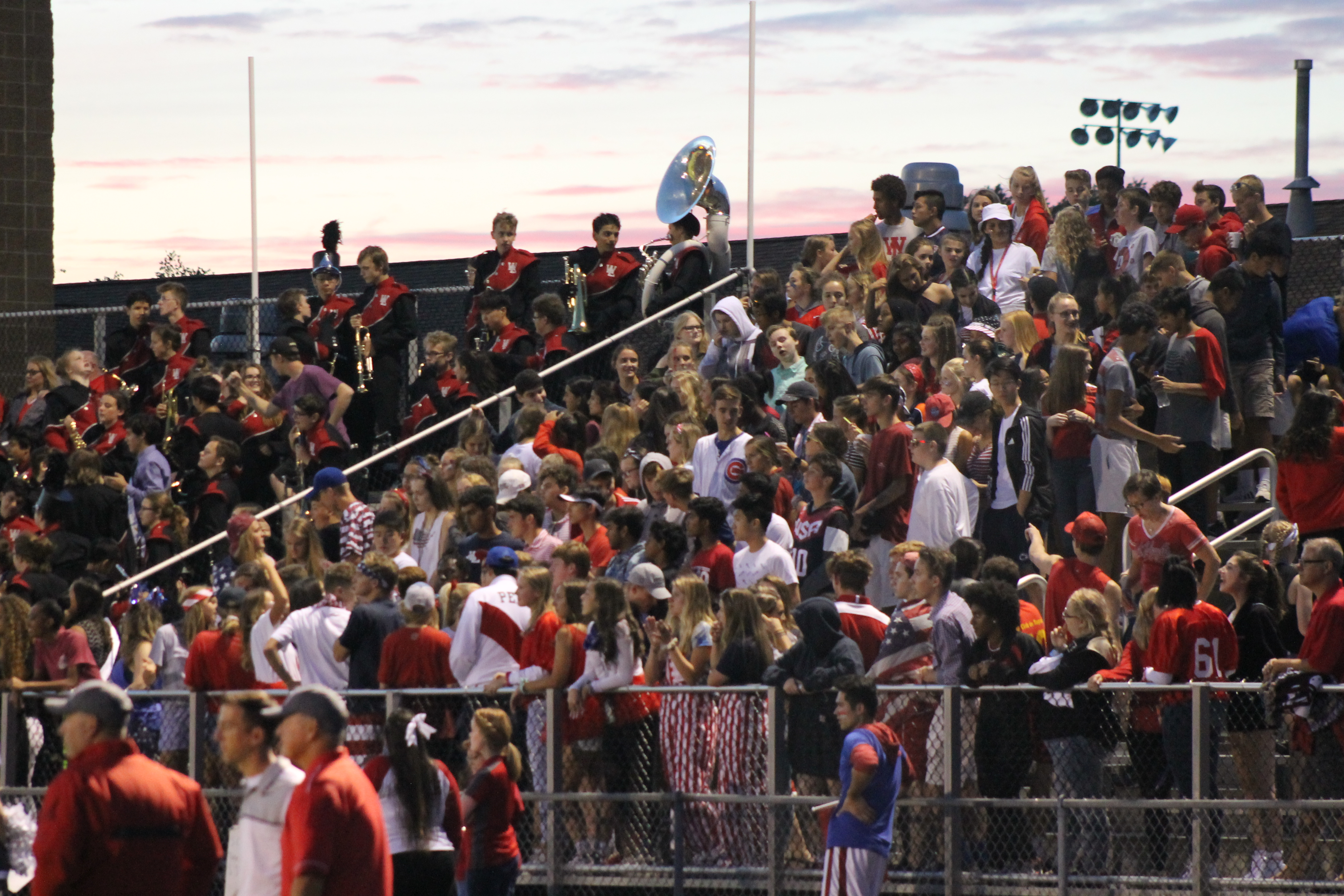 "RED DEVIL PRIDE: The students watch the game with such passion and admiration. ""Everyone was jumping around a lot cause we knew we were going to win, and good vibes were going round,"" Andrianna Psarros, 12, said."