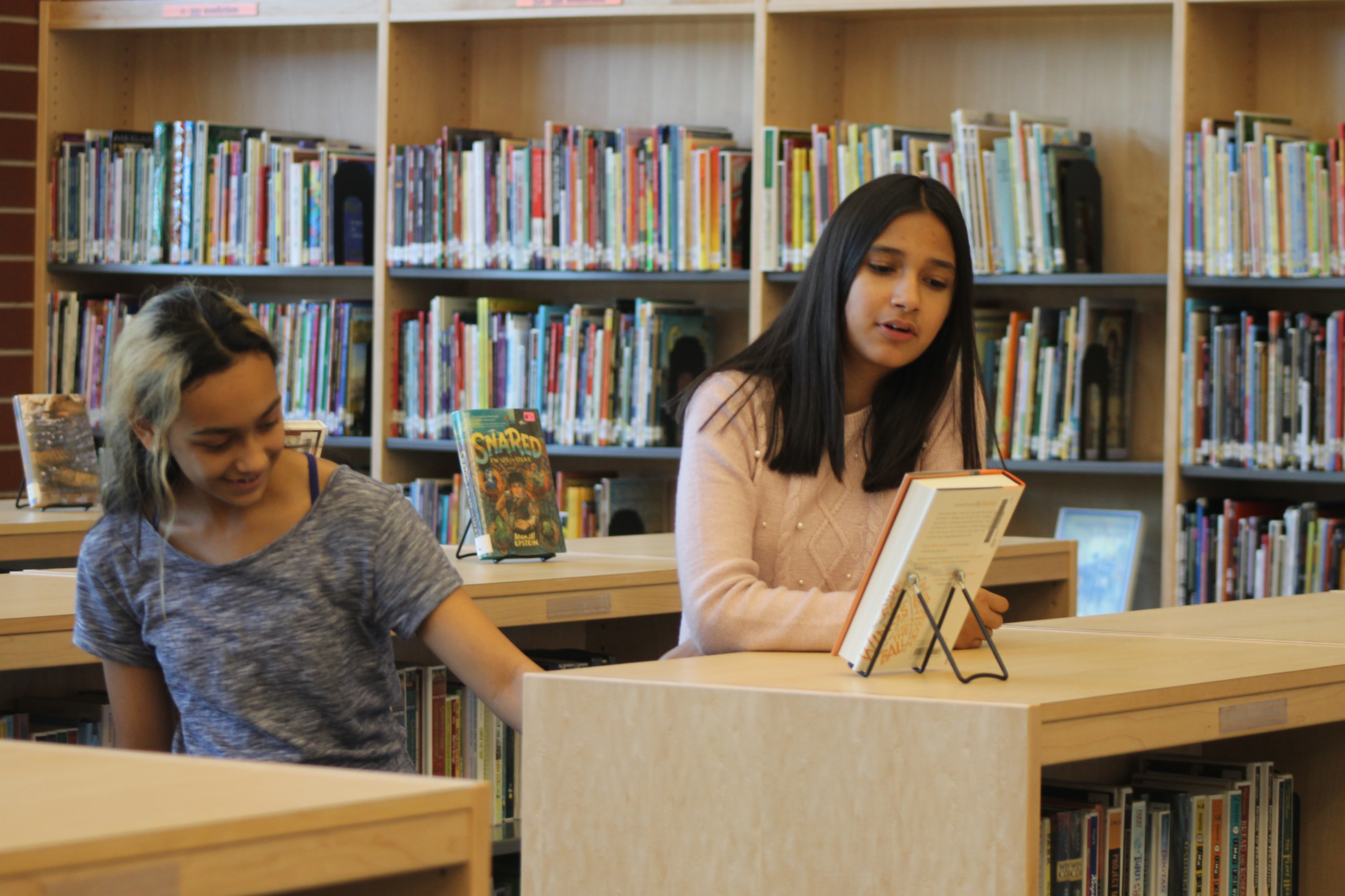 "EXPLORE THE NEW WHITMAN MEDIA CENTER: Students course through the Whitman Media Center following ribbon cutting ceremonies for West Lafayette Intermediate School Wednesday, October 10, 2018. Whitman Media Center is named for Mary Beth Whitman, who taught in West Lafayette Community School Corp for 38 years. ""The Library is so magical and comfortable and I can't wait to dive into the books here,"" said Keya Poderycki, a sixth grader at WLIS."